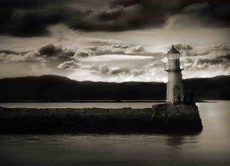 a light house in the dark seaside
