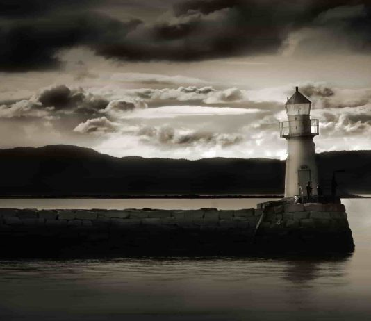 a light house in the dark seaside