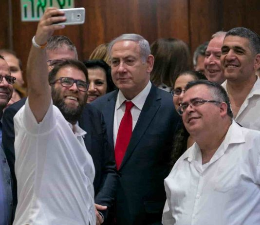 Netanyahu and others taking selfie after the bill in parliament