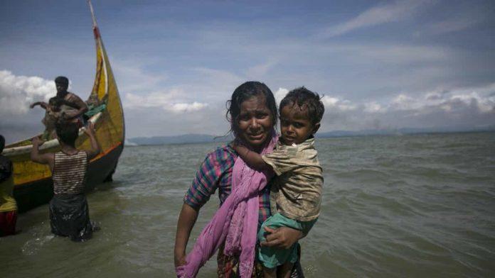 Rohingya women with child in sea