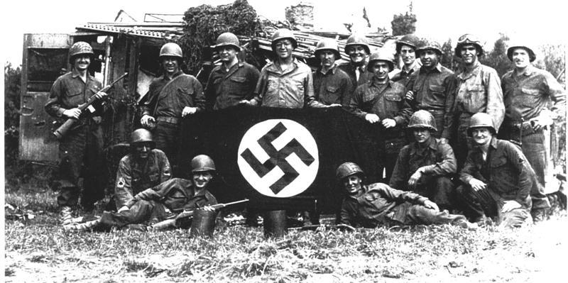 Nazi Soldiers Holding Nazi Symbol